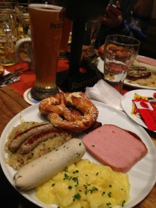 A protein-packed meal in Munich with a variety of sausage, potatoes, pretzels, and sauerkraut. (photo by Richelle Szypulski)