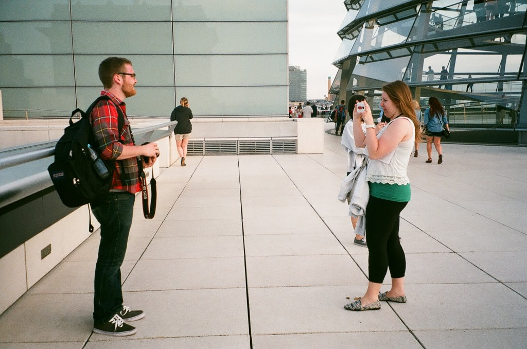 Alexa takes Zack's photograph on the outside deck of the Reichstag.