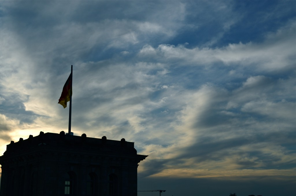 The German flag and evening sky from atop the Reichstag.