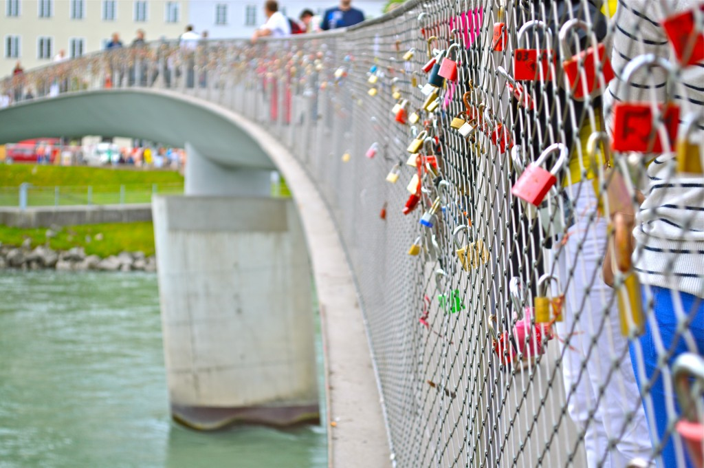 The Students observe the love locks placed on the Markarsteg Bridge in Salzburg Austria.