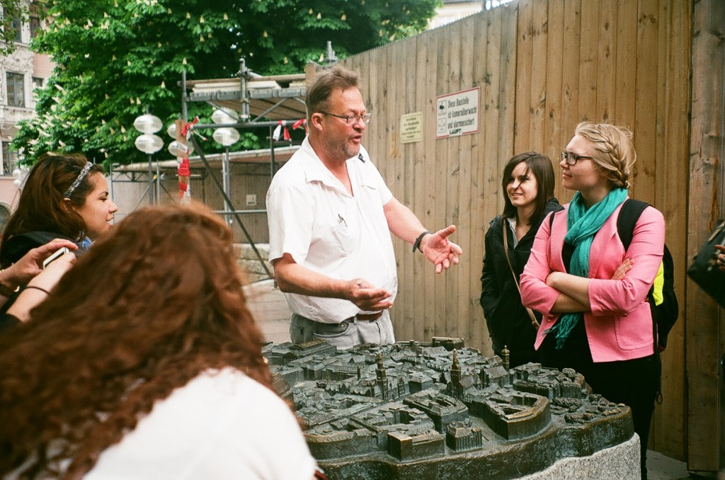 Munich tour guide Anroud Beck explains a model of the rebuilt Munich to students on the day they arrived.