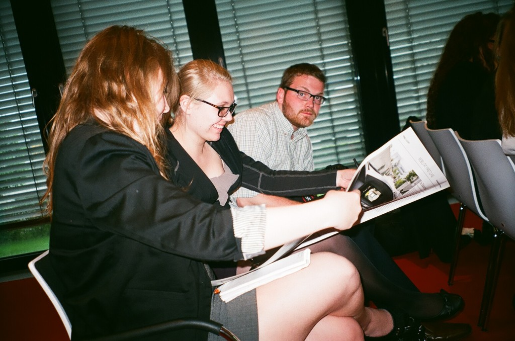 Alexa Blanchard and Johnie Freiwald check out a special advertisement in the pages of Munich's Sueddeutsche Zeitung.