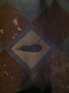The devil's footprint sits on a tile inside the church. (photo by Carson Allwes)