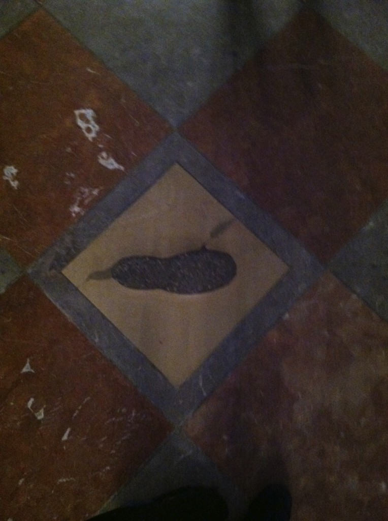 The devil's footprint sits on a tile inside the church.
